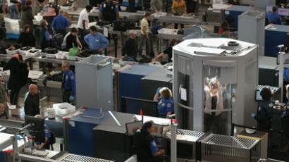 A traveler undergoes a full body scan performed by Transportation Security Administration agents as she and others pass through the security checkpoint at the Denver International Airport on November 22, 2010 in Denver, Colorado.(AFP Photo / John Moore)
