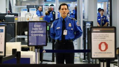 A TSA agent waits for passengers to use the TSA PreCheck lane being implemented by the Transportation Security Administration at Miami International Airport.(AFP Photo / Joe Raedle)