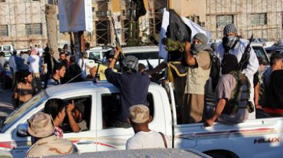 "Islamists hold weapons as hundreds of heavily armed Libyans from a ""Pro Sharia"" group demonstrate.(AFP Photo / Abdullah Doma)"