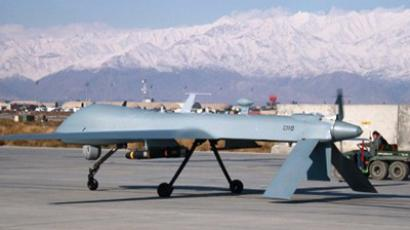 A US Predator unmanned drone armed with a missile setting off from its hangar at Bagram air base in Afghanistan (AFP Photo / Files / Bonny Schoonakker)