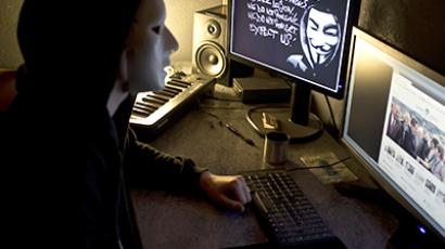 A masked hacker, part of the Anonymous group. (AFP Photo / Jean-Philippe Ksiazek)