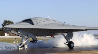 A launch crew prepares a Northrop Grumman X-47B Unmanned Combat Air System (UCAS) demonstrator for its first land-based catapult launch on November 29, 2012. (Reuters/U.S. Navy/Courtesy of Northrop Grumman/Alan Radecki/Handout) Video courtesy of the US Navy's YouTube Channel.