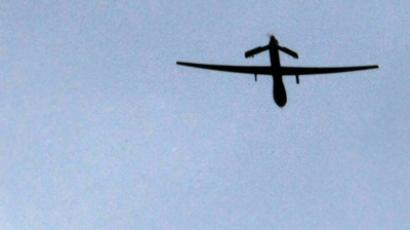 "An archive photo shows a US ""Predator"" drone passing overhead at a forward operating base near Kandahar, Afghanistan. (AFP Photo / Joel Saget)"