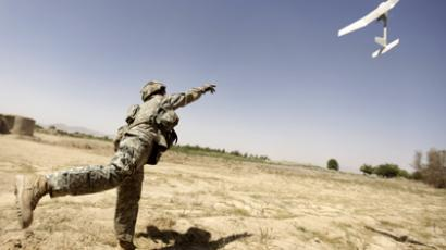 A US army soldier with the 101st Airborne Division Alpha Battery 1-320th tries to launch a drone outside Combat Outpost Nolen in the village of Jellawar in The Arghandab Valley (AFP Photo / Patrick Baz)