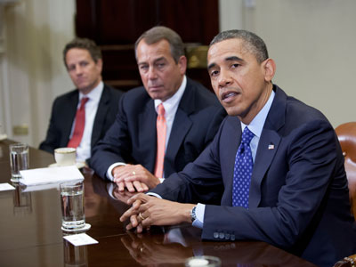 US President Barack Obama speaks before Speaker John Boehner (R-OH) Secretary of the Treasury Timothy Geithner (3rdR) and other cabinet members during a meeting.(AFP Photo / Toby Jorrin)