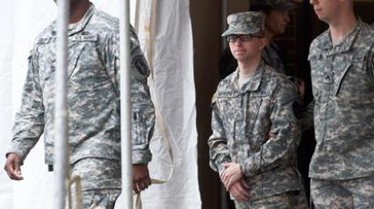 Army Pfc. Bradley Manning (C) is escorted by military police from the courthouse, Maryland, December 21, 2011 (Reuters / Benjamin Myers)
