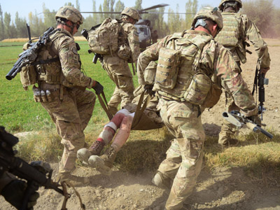 US Army soldiers attached to 2nd platoon, C troop, 1st Squadron (Airborne), 91st U.S Cavalry Regiment, 173rd Airborne Brigade Combat Team operating under NATO sponsored International Security Assistance Force (ISAF) carry a wounded colleague after he was injured in an Improvised Explosive Device (IED) blast during a patrol near Baraki Barak base in Logar Province on October 13, 2012. (AFP Photo/Munir uz Zaman)