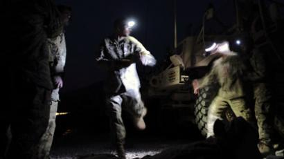 U.S. Army soldiers from the Alpha Company 2nd battalion 27th infantry regiment, Task Forces Bronco, participate in an exercise to simulate a night time mission in the FOB Bostick at Naray district in Kunar province, eastern Afghanistan. (Reuters / Nikola Solic)