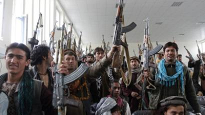 Taliban militants, part of a group of a hundred Afghan Talibans, hand over their weapons as they take part in the Afghan government's reconciliation and reintegration program in Laghman province March 12, 2012. (Reuters/Parwiz)