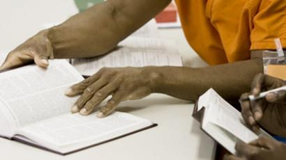 US prison bans all books – except The Bible (AFP Photo / Paul J. Richards)