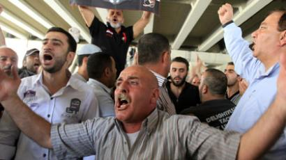 Syrian men shout slogans during a pro-regime protest (AFP Photo/Louai Beshara)