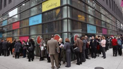 People stand in a line that stretched around the block to enter a job fair held at the Jewish Community Center (JCC), on March 21, 2012 in New York City.(AFP Photo / John Moore)