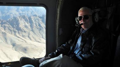 U.S. Defense Secretary Robert Gates rides in a Black Hawk helicopter as he flies above Kandahar province March 8, 2011