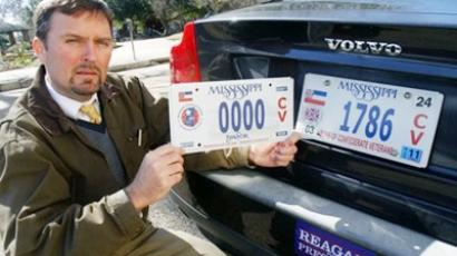 Greg Stewart, a member of the Mississippi  Division, Sons of Confederate Veterans, displays a sample of the latest Civil War sesquicentennial tag that is being sold, left, adjacent to the current tag in Jackson, Miss. , Tuesday, Feb. 8, 2011