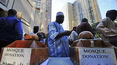 US, New York: Donation boxes stand outside one of Manhattan's main mosque as believers leave Eid al-Fitr prayers, September 10, 2010, in New York. Eid al-Fitr marks the day when Muslims worldwide celebrate the end of the fasting month of Ramadan. (AFP Photo / Emmanuel Dunand)
