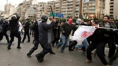 Lebanese anti-riot police use batons as they clash with anti-Hosni Mubarak demonstrators outside the Egyptian embassy in Beirut on February 3, 2011 (AFP Photo / STR)
