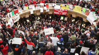 Protestors demonstrate in the rotunda of the state capitol on February 24, 2011 in Madison, Wisconsin
