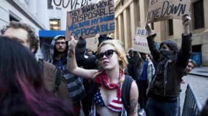 Protestors hold up signs during a demostration on September 19, 2011 in New York City (Michael Nagle / Getty Images / AFP)