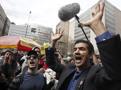 Occupy Wall Street movement supporters protest during a march from Zuccotti Park to Union Square to protest perceived police brutality in New York, March 24, 2012. (Reuters / Carlo Allegri)