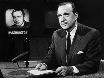 Walter Cronkite sits at the news desk at CBS Television's studio, where he anchored the news program, January, 1963 (Photo by Bettmann)