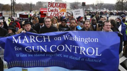 Washington DC Mayor Vincent Gray (4th L) helps lead the March on Washington for Gun Control on the National Mall in Washington, January 26, 2013. (Reuters / Jonathan Ernst)