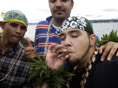 Tori Taueu-Misa smokes a large marijuana joint at Hempfest  in Seattle, Washington.(AFP Photo / Ron Wurzer)