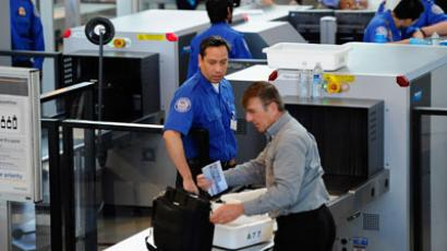 Transportation Security Administration (TSA) agents screen passengers at Los Angeles International Airport.(AFP Photo / Kevork Djansezian)