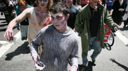 Zombies march around streets of San Francisco giving out blood pops and stickers to promote Zynga's new zombie game for iPhone.(AFP Photo / Kimihiro Hoshino)