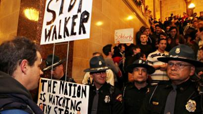 Wisconsin State Police officers block a stairwell leading up to the senate chambers as protestors occupy the Wisconsin State Capitol on March 9, 2011 in Madison, Wisconsin
