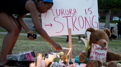 Mourners at a vigil light candles near theater where 12 people were killed July 20, 2012 in Aurora, Colorado (AFP Photo  / Don Emmert)
