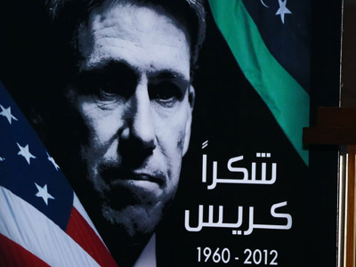 "A portrait of late US Ambassador to Libya Chris Steven and an Arabic sign which reads ""Thanks Chris""(AFP Photo/Mahmud Turkia)"