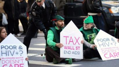 AIDS protesters sit down in the street after marching up Broadway from Zuccotti Park on World AIDS Day on December 1, 2011 in New York City. (Spencer Platt/Getty Images/AFP)