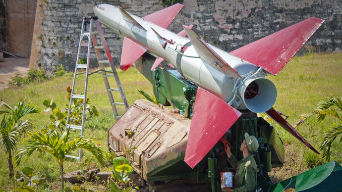 A Cuban soldier paints a SAM-2 missile deployed during the missile crisis of 1962 at Morro Cabana complex, on October 11, 2012 in Havana.(AFP Photo / STR)