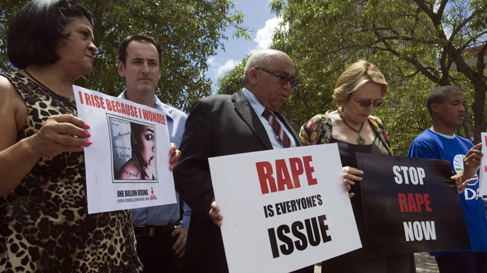 Western Cape Province Premier and leader of the opposition Democratic Alliance (DA) party Helen Zille (2nd R) joins a protest to against rape on February 11, 2013.(AFP Photo / Rdger Bosch)