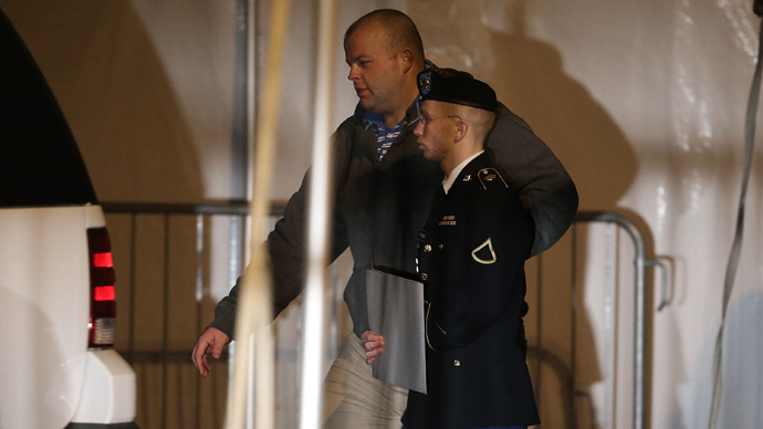 Pfc. Bradley E. Manning is escorted from a hearing, on February 28, 2013 in Fort Meade, Maryland (Mark Wilson / Getty Images / AFP)