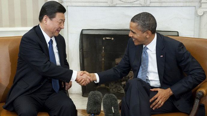 US President Barack Obama shakes hands with Chinese Vice President Xi Jinping during meetings in the Oval Office of the White House in Washington, DC, February 14, 2012. (AFP Photo / Saul Loeb)