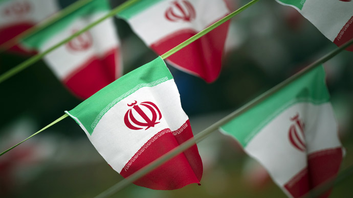 Iran's national flags (Reuters/Morteza Nikoubazl)