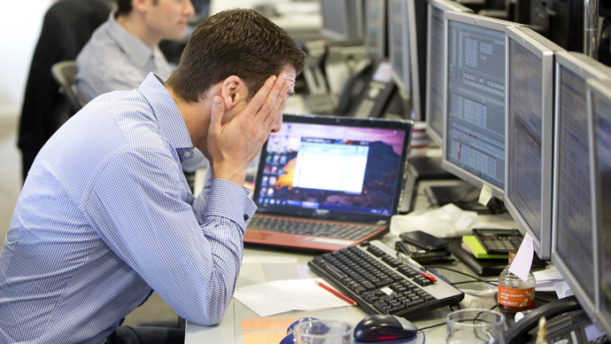 A trader reacts on the IG Group trading floor in London March 18, 2013. (Reuters/Neil Hall)