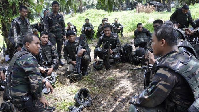 Malaysian soldiers preparing for an operation in the area of Sungai Nyamuk where Filipino gunmen were locked down in a stand off in the surrounding villages of Tanduo, in Sabah. (AFP Photo / Malaysia Ministry of Defence)