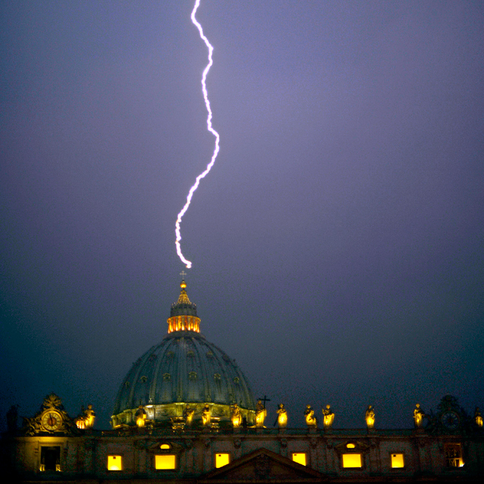 A lightning strikes St Peter's dome at the Vatican on February 11, 2013. Pope Benedict XVI announced today he will resign as leader of the world's 1.1 billion Catholics on February 28 (AFP Photo / Filippo Monteforte)