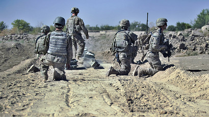 US Army troops from C-Company. 1st platoon, 1-23 infantry prepare to deploy 'A-pops' - charges fired by rocket onto surfaces suspected to have IED (improvised explosive devices) traps which explode and trigger the safe detonation of the devices at the village of Gerandai in Panjway district, Kandahar Province on September 21, 2012. (AFP Photo)