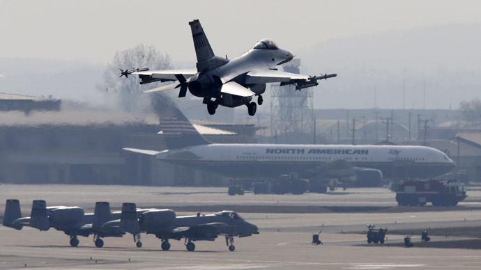 An A-10 jet (top) belonging to the U.S. Air Force comes in for a landing at a U.S. air force base in Osan, south of Seoul April 3, 2013.  (Reuters/Lee Jae-Won)