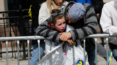 A child is comforted after explosions went off at the 117th Boston Marathon in Boston, Massachusetts April 15, 2013 (Reuters / Jessica Rinaldi)