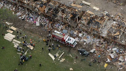 Search and rescue workers comb through what remains of a 50-unit apartment building the day after an explosion at the West Fertilizer Company destroyed the building April 18, 2013 in West, Texas. (Chip Somodevilla/Getty Images/AFP)