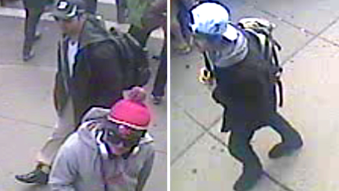 These images taken from a video released by the FBI on April 18, 2013 shows Suspect One (L) and Suspect Two (R) walking along the route of the Boston Marathon on April 15, 2013 (AFP Photo / FBI)