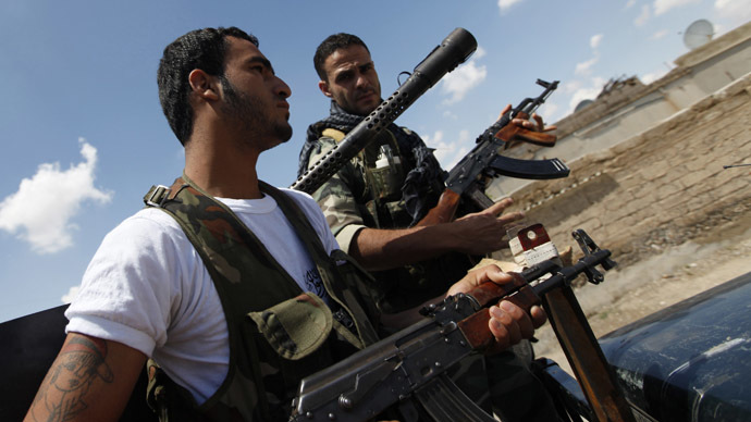 Free Syrian Army fighters hold their weapons in Raqqa province, east Syria (Reuters/Hamid Khatib)