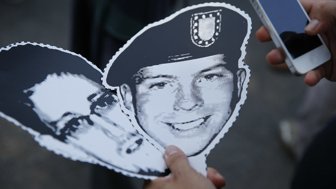 A member of German Piraten Partei (Pirates party) holds the portraits of U.S. Army Private First Class Bradley Manning and Edward Snowden (R), a former contractor at the National Security Agency (NSA), during a protest in Berlin's Tiergarten district, June 19, 2013. (Reuters)