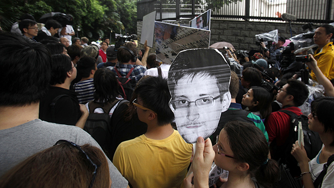 A protester carries a paper cutout of Snowden (Reuters / Bobby Yip)