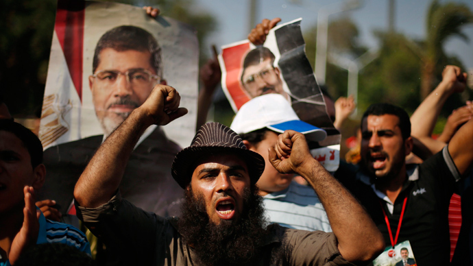 Supporters of deposed Egyptian President Mohamed Mursi shout slogans during a protest near Cairo University in Cairo July 6, 2013 (Reuters / Suhaib Salem)
