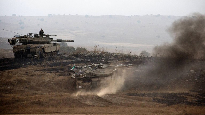 Israeli Merkava tanks roll during a military exercise in the Israeli-annexed Golan Heights near the border with Syria on July 18, 2013. (AFP Photo / Jack Guez)